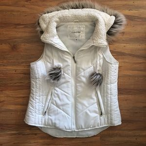 Maurice white puffer vest with fur hood.
